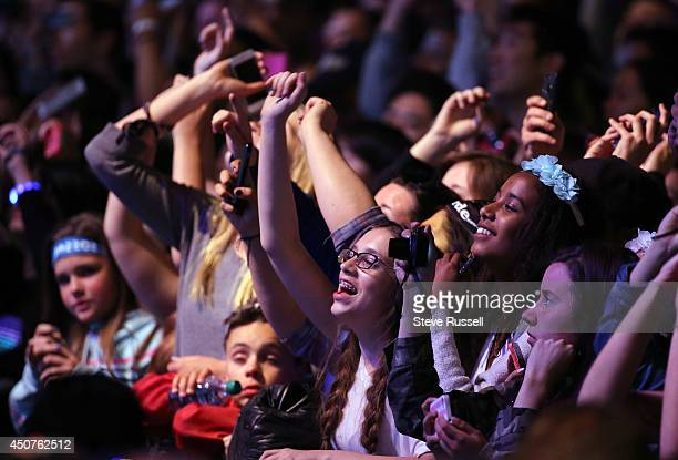 TORONTO ON JUNE 15 Fans sing along as Imagine Dragons perform 'Demons 303' and 'Radioactive 429' at the Much Music Video Awards at MuchMusic on Queen...