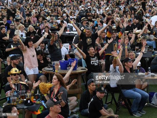 Fans sing and dance as the Village People song 'YMCA' is played during a Vegas Golden Knights road game watch party at the Downtown Las Vegas Events...