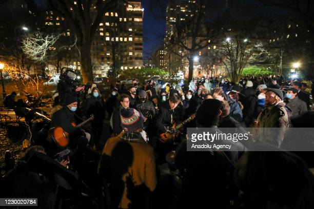 Fans sing Beatles songs as they pay tribute to 40th anniversary of John Lennons death at the John Lennon Memorial in Central Park, New York City,...