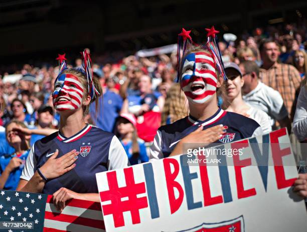 USA fans sing during the National Anthem before a Group C football match between Nigeria and USA at BC Place Stadium in Vancouver during the FIFA...