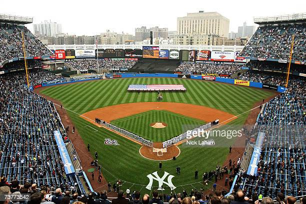 Fans sing the national anthem before the New York Yankees play the Tampa Bay Devil Rays during their Opening Day game at Yankee Stadium April 2, 2007...