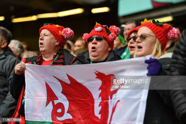 Fans sing the national anthem prior to the Guinness Six Nations match between Wales and Ireland at Principality Stadium on March 16 2019 in Cardiff...