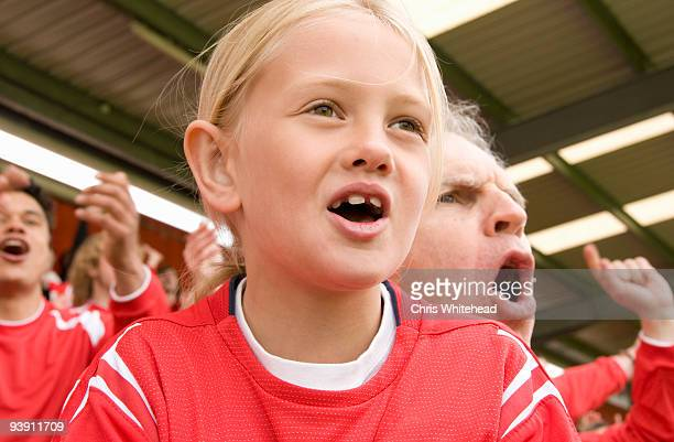 fans singing at football match - match sport stock pictures, royalty-free photos & images