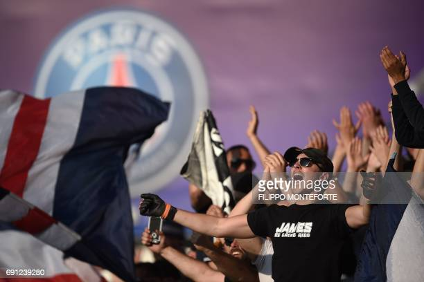 PSG fans singing in the crowd ahead of the UEFA Women's Champions League final football match between Lyon and Paris SaintGermain at the Cardiff City...