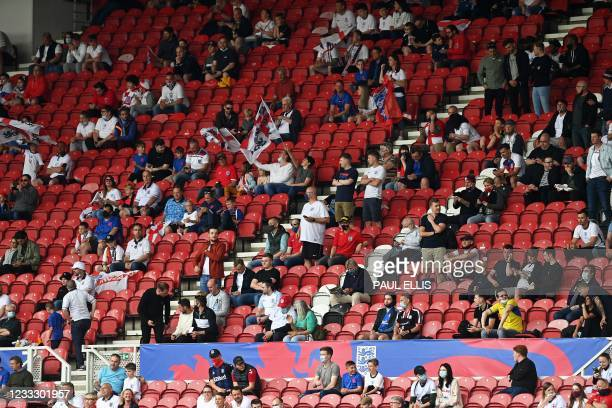 Fans sit at a social distance in the stands ahead of the international friendly football match between England and Romania at the Riverside Stadium...