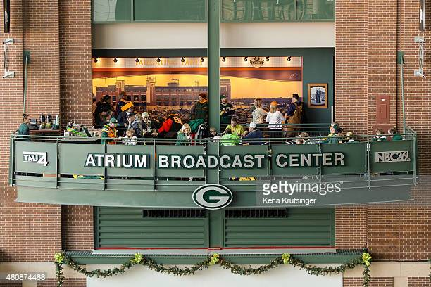 Fans sit in the atrium broadcasting center at Lambeau Field prior to the NFL game between the Detroit Lions and the Green Bay Packers on December 28...