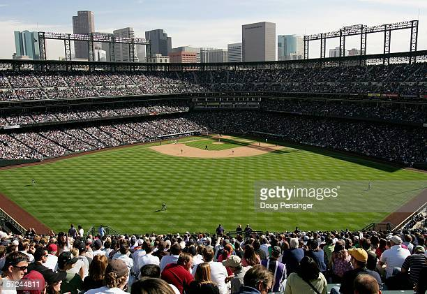 Fans sit in the 'Rock Pile' bleachers at Coors Field on opening day April 3 2006 in Denver Colorado The Colorado Rockies defeated the Arizona...