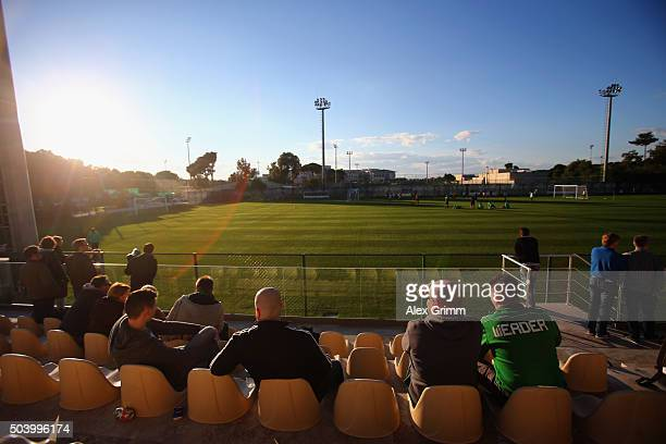 Fans sit in the stand during a Werder Bremen training session on day 3 of the Bundesliga Belek training camps at Regnum Sports Center on January 8...