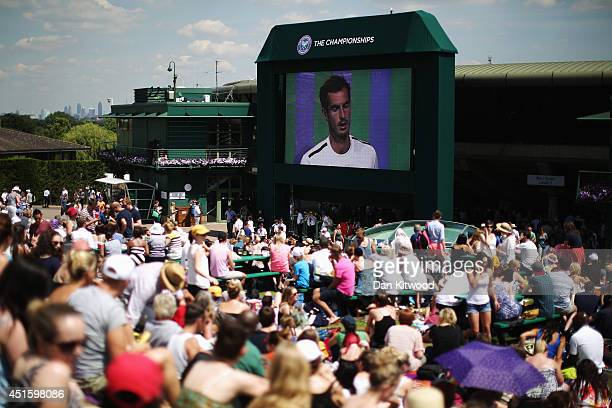 Fans sit on Murray mound as they watch the Andy Murray against Grigor Dimitrov match on day nine the Wimbledon Lawn Tennis Championships at the All...