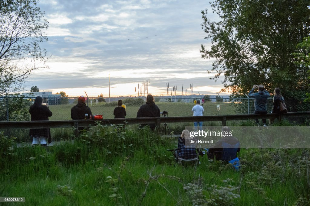 Fans sit outside the fence at the Soundgarden sculpture reflecting on Chris Cornell and sharing stories at Magnuson Park on May 18, 2017 in Seattle, Washington. Cornell, of the bands Soundgarden and Audioslave, died unexpectedly on Wednesday. He was 52 years old.