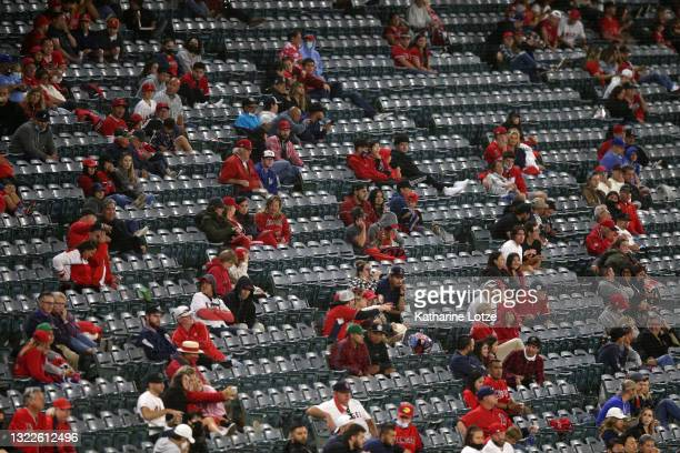Fans sit socially distanced in the stands during a game between the Los Angeles Angels and the Kansas City Royals at Angel Stadium of Anaheim on June...