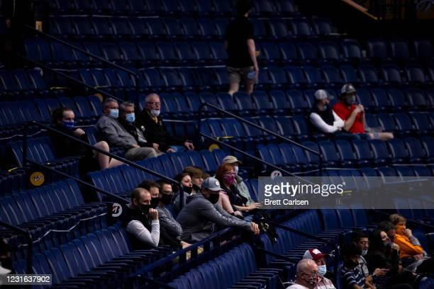 Fans sit socially distanced wearing masks as they watch the game between the Vanderbilt Commodores and the Texas A&M Aggies during the first half at...