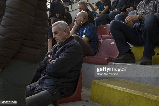 Fans sitting waiting for the teams to emerge at the Stadio Giuseppe Meazza also known as the San Siro before Internationale took on Cagliari in an...