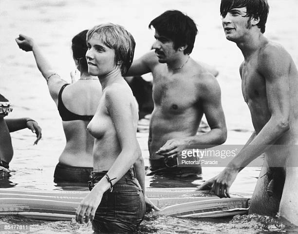 Fans skinnydipping in Filippini Pond during the Woodstock Music Festival Bethel New York 15th17th August 1969