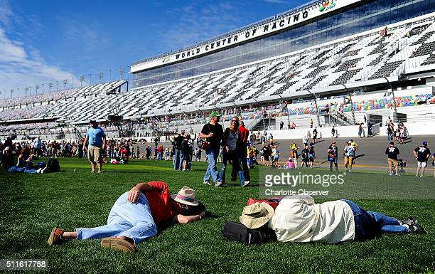 Fans sleep on the infield grass in the front stretch of Daytona International Speedway in Daytona Beach Fla on Sunday Feb 21 2016