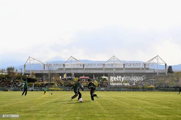 Fans spend time outside the stadium prior to the JLeague J2 match between Matsumoto Yamaga and Kamatamare Sanuki at Matsumotodaira Park Stadium on...