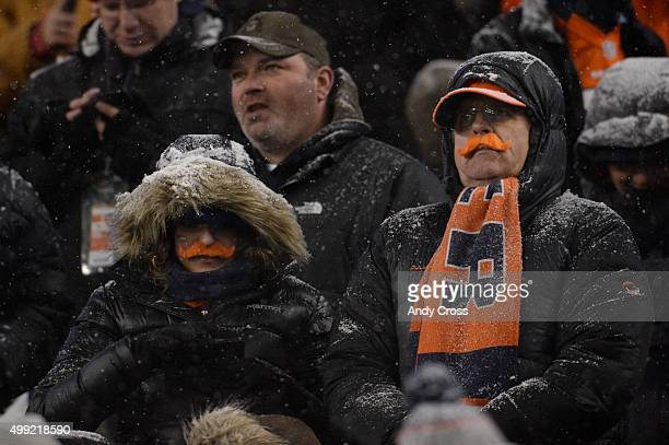 Fans sport orange mustaches in an attempt to break a world record The Broncos played the New England Patriots at Sports Authority Field at Mile High...