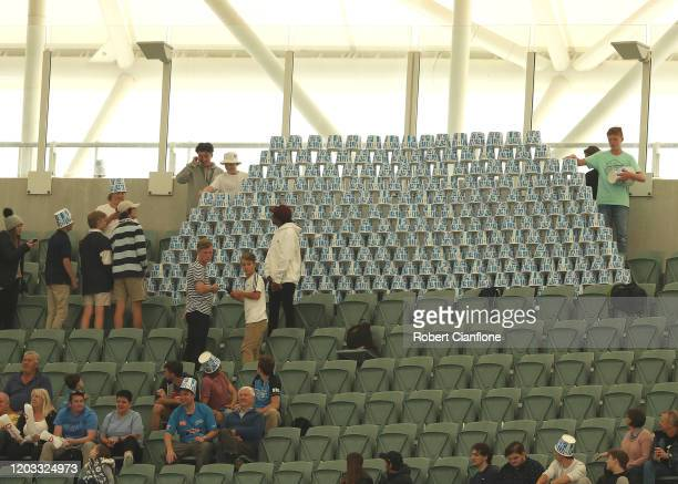 Fans stack up their bucket hats during the Big bash League Finals match between the Adelaide Strikers and the Sydney Thunder at Adelaide Oval on...