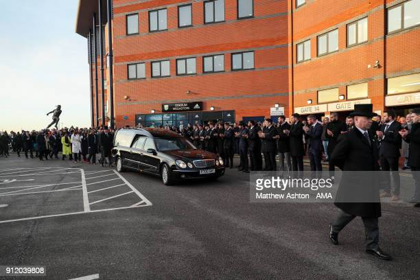 Fans Staff and Players of West Bromwich Albion applaud as the Hearse arrives during the Cyrille Regis Memorial Service at The Hawthorns on January 30...