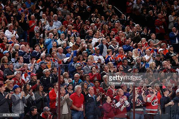 Fans stand and cheer during the NHL game between the Arizona Coyotes ands the Edmonton Oilers at Gila River Arena on November 12 2015 in Glendale...