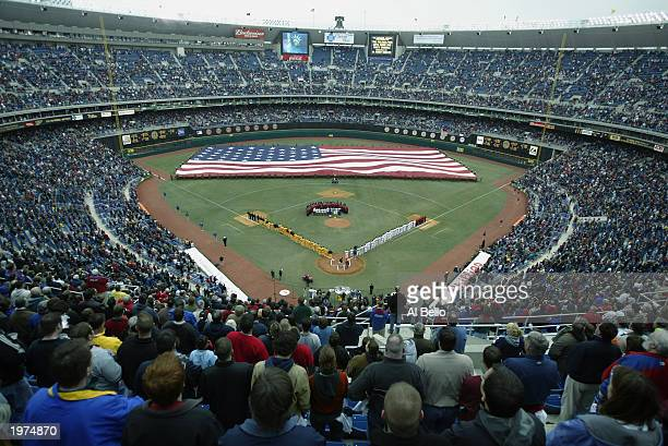 Fans stand at attention during the national anthem before the home opener between the Philadelphia Phillies and the Pittsburgh Pirates at Veterans...