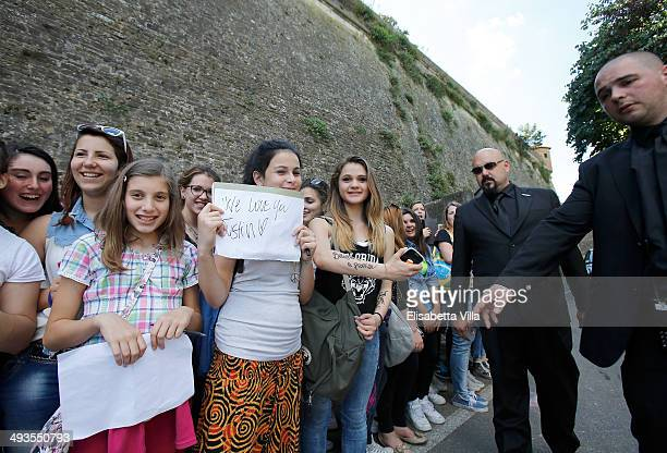 Fans stand at the entrance of Fortezza Belvedere ahead of Kim Kardashian and Kanye West's Wedding on May 24 2014 in Florence Italy