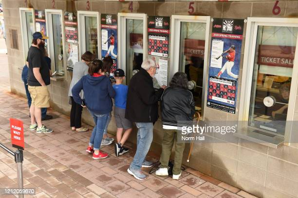 Fans stand at the ticket counters to get refunds after Major League Baseball suspends Spring Training at Goodyear Ballpark on March 12, 2020 in...