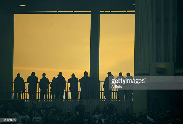 Fans stand during the Baltimore Ravens against the Tennessee Titans as the sun sets behind them during a AFC wildcard playoff game at M T Bank...