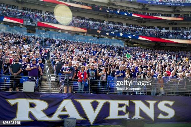 Fans stand during the national anthem before the Baltimore Ravens take on the Pittsburgh Steelers at MT Bank Stadium on October 1 2017 in Baltimore...