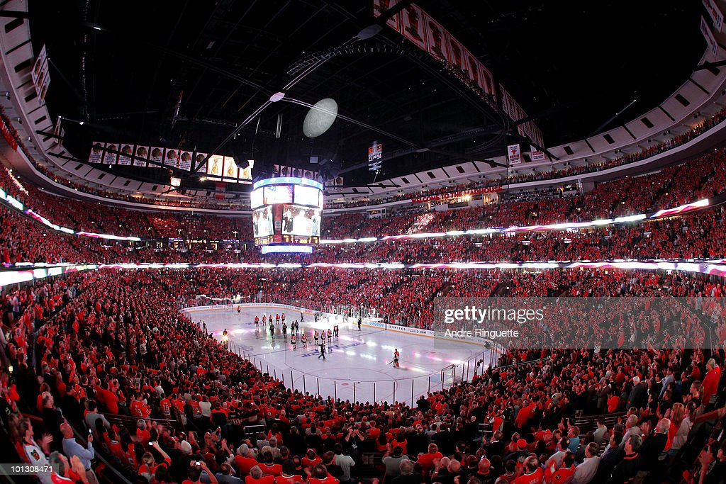 Fans stand during the National Anthem before the Chicago Blackhawks play against the Philadelphia Flyers in Game Two of the 2010 NHL Stanley Cup Final at the United Center on May 31, 2010 in Chicago, Illinois.