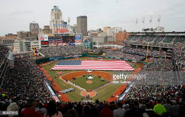 Fans stand during the national anthem before the Opening Day game between the Cleveland Indians versus Chicago White Sox at Progressive Field on...