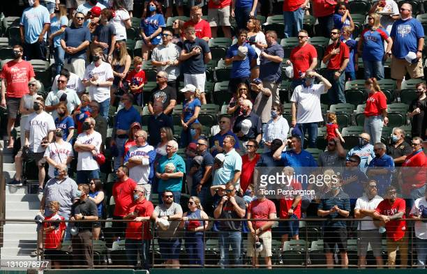 Fans stand for the National Anthem before the Texas Rangers take on the Toronto Blue Jays on Opening Day at Globe Life Field on April 05, 2021 in...