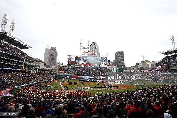 Fans stand for the national anthem prior to the start of the Cleveland Indians and Toronto Blue Jays game April 10 2009 at Progressive Field in...