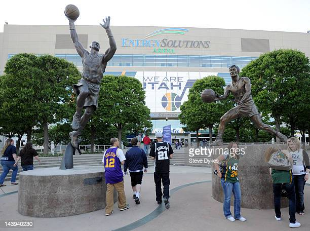 Fans stand in font of statues of Karl Malone and John Stockton before Game Three of the Western Conference Quarterfinals in the 2012 NBA Playoffs at...