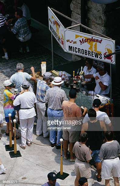 Fans stand in line to buy beer during a baseball game at Comiskey Park circa 1991 in Chicago Illinois