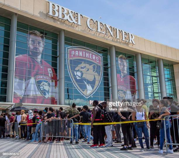 Fans stand in the heat as they wait for the doors to open at the BBT Center for the memorial service in honor of slain rapper XXXTentacion in Sunrise...