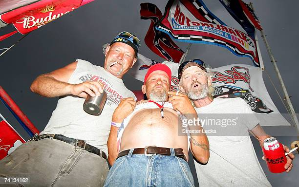 Fans stand in the rain as they await the start of the NASCAR Nextel Cup Series Dodge Avenger 500 on May 12, 2007 at Darlington Raceway in Darlington,...