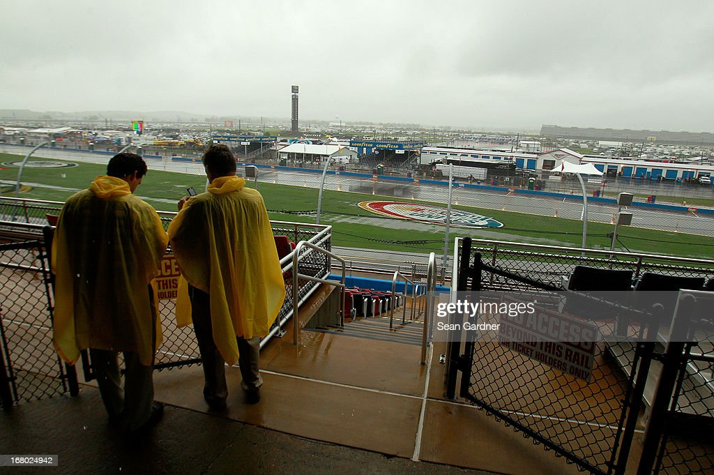 Fans stand on a platform at the top of the grandstand to avoid standing in the rain during qualifying for the NASCAR Sprint Cup Series Aaron's 499 at Talladega Superspeedway on May 4, 2013 in Talladega, Alabama. Sprint Cup qualifying was officially canceled due to inclimate weather.