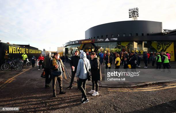 Fans stand outside the stadium before the Premier League match between Watford and West Ham United at Vicarage Road on November 19 2017 in Watford...