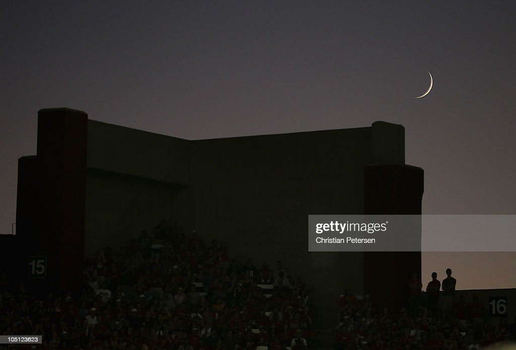 Fans stand under a waxing crescent moon as they watch the college football game between the Arizona Wildcats and the Oregon State Beavers at Arizona Stadium on October 9, 2010 in Tucson, Arizona. The Beavers defeated the Wildcats 29-27.