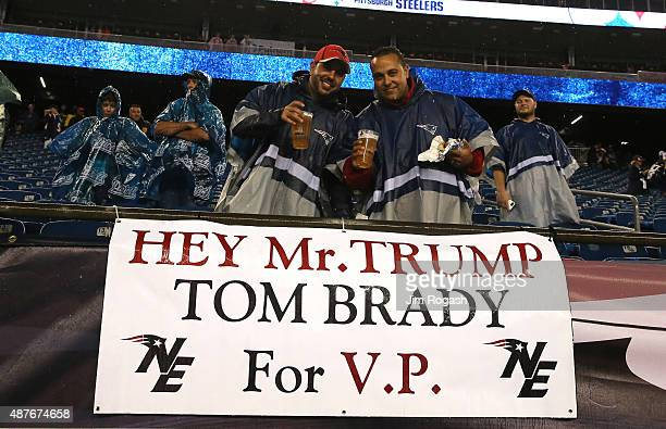 Fans stand with a sign stating 'Hey Mr Trump Tom Brady for VP' before the game between the New England Patriots and the Pittsburgh Steelers at...