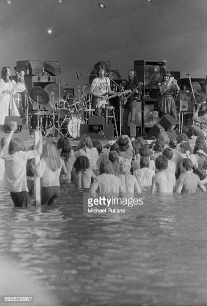 Fans standing in the lake to watch Eric Clapton performing with his band at the Garden Party IX festival at Crystal Palace Bowl London 31st July 1976