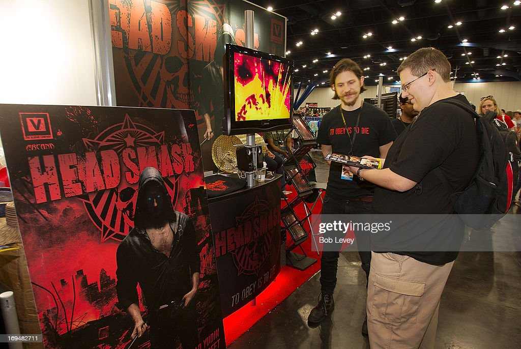 Fans stop by the Head Smash booth as The Vladar Company Presents: HEAD SMASH Special Preview Edition At Houston's COMICPALOOZA at George R. Brown Convention Center on May 25, 2013 in Houston, Texas.