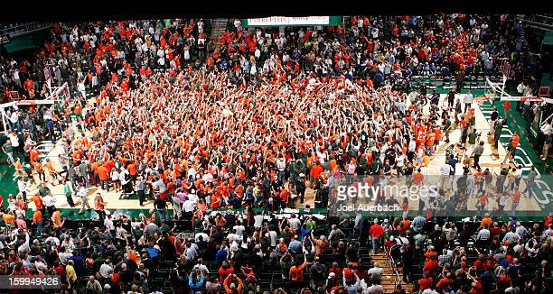 Fans storm the court after the Miami Hurricanes defeated the Duke Blue Devils on January 23, 2013 at the BankUnited Center in Coral Gables, Florida....