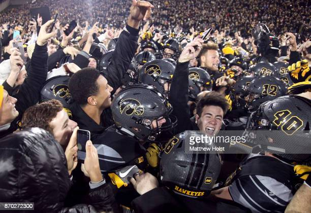 Fans storm the field after the Iowa Hawkeyes upset the Ohio State Buckeyes on November 04 2017 at Kinnick Stadium in Iowa City Iowa
