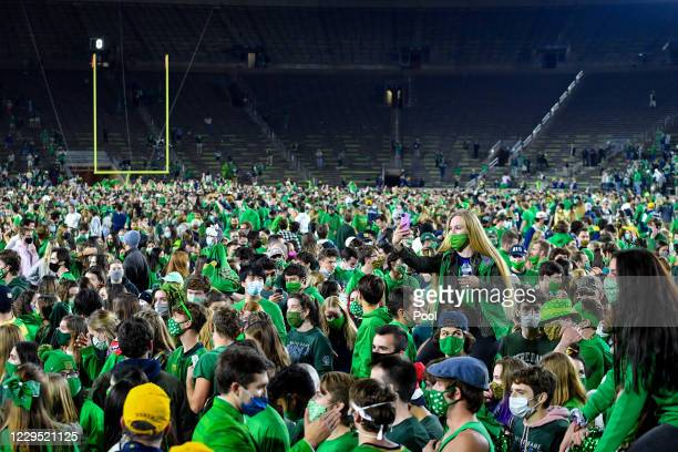 Fans storm the field after the Notre Dame Fighting Irish defeated the Clemson Tigers 47-40 in double overtime at Notre Dame Stadium on November 7,...