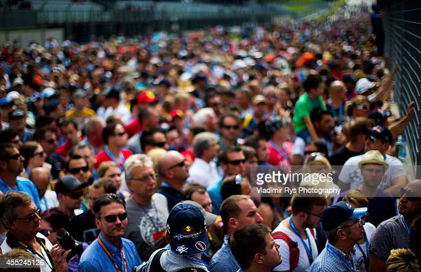 Fans storm the start finish straight for the driver's autograph session during previews for the Austrian Formula One Grand Prix at Red Bull Ring on...