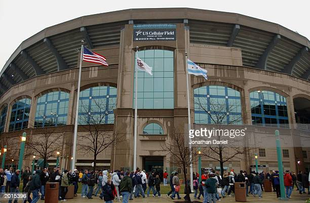 Fans stream into US Cellular Field in the rain before an opening day game between the Chicago White Sox and the Detroit Tigers on April 4 2003 at US...