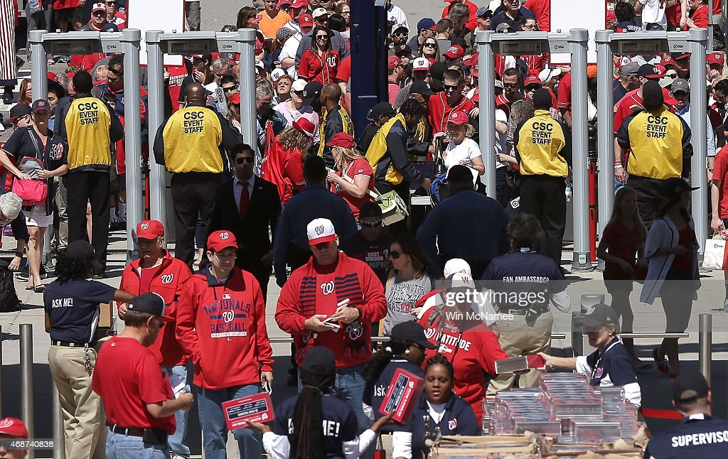 Fans stream through newly installed metal detectors at Nationals Park prior to the Washington Nationals Opening Day game againt the New York Mets at Nationals Park on April 6, 2015 in Washington, DC.