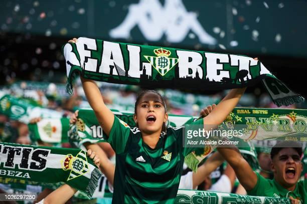 Fans support Real Betis Balompie during the La Liga match between Real Betis Balompie and Sevilla FC at Estadio Benito Villamarin on September 2 2018...